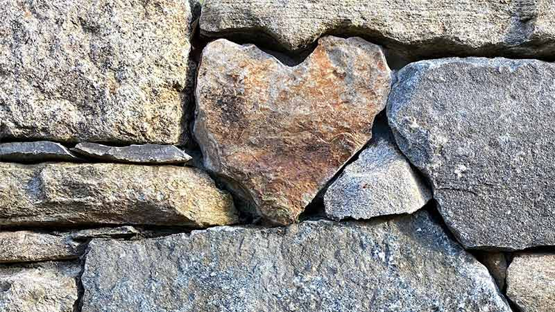 Heart shaped stone in wall