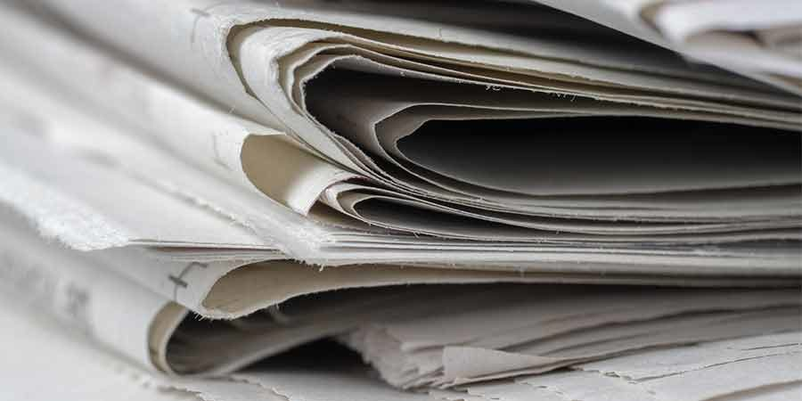 a stack of newspapers viewed from teh side